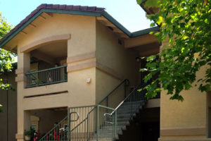 Exterior of Sierra Creek with stairs leading up to apartments
