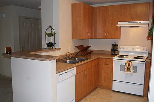 Kitchen with oven, sink, dishwasher and cabinets