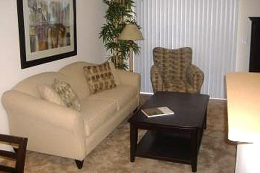 Living room with couch, chair and coffee table